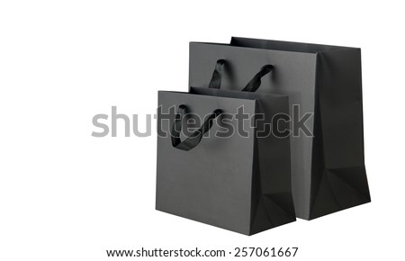 Black shopping bags on white. - stock photo