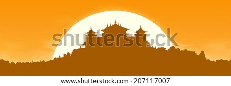 black silhouette of a traditional Tibetan Buddhist monastery on the hill covered with vegetation at sunrise, large panoramic view - stock photo