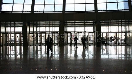 Black silhouette of people against a solar exit from a dark passage. Back lighting. - stock photo