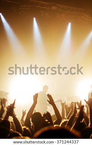 Black silhouette of rockstar on concert, guitarist - stock photo