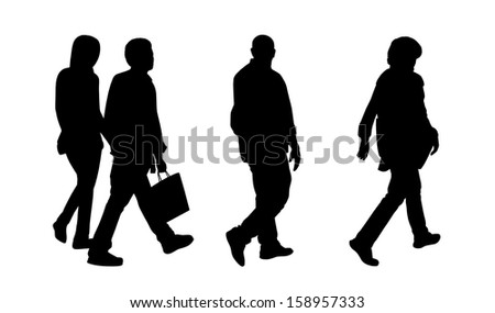 black silhouettes of a middle age man, woman and a young couple walking in the street - stock photo