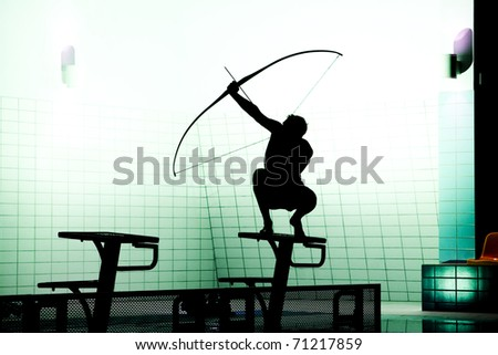 black silhoutte of archer - stock photo