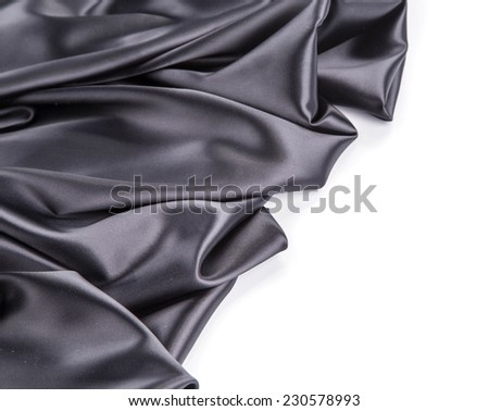 Black silk drapery. Isolated on a white background.  - stock photo