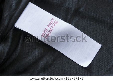 Black silk with white label with notification - stock photo