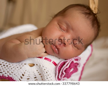 Black small newborn baby sleeping closeup. Selective focus on the baby's face. - stock photo