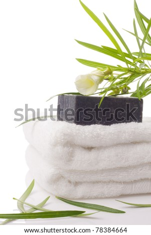 black soap on towel with flower on white - stock photo