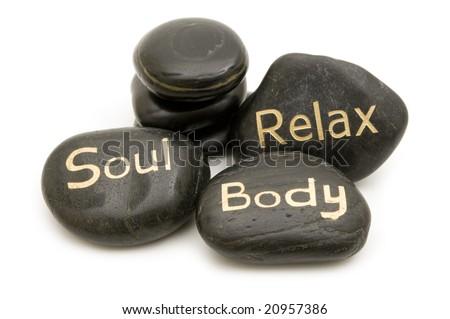 black spa massage stones on white background - stock photo