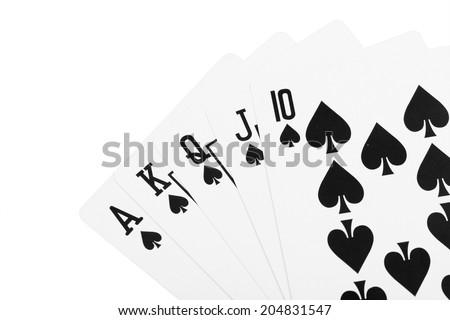 Black spade royal straight flush poker card - stock photo