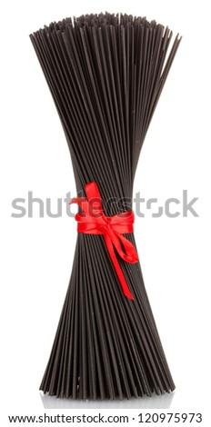 Black spaghetti with ribbon isolated on white - stock photo