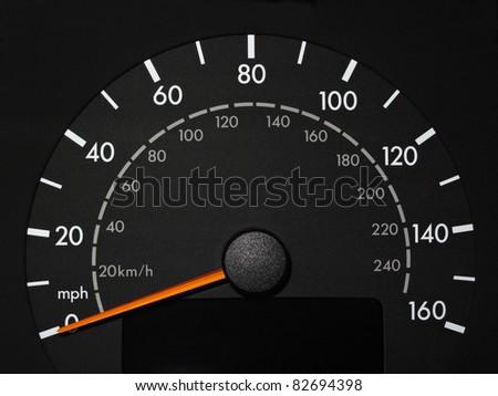 Black Speedometer with Orange Needle - stock photo