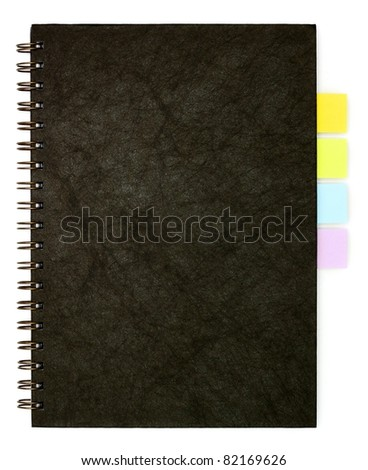 black spiral note book and post it - stock photo