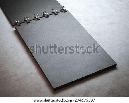 Black spiral notepad  - stock photo
