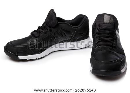 Black sport shoes on white background - stock photo