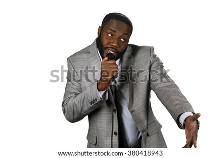Black stand-up comedian. Darkskinned comedian perfrorming. Comedian's funny story. Telling jokes on stage. - stock photo