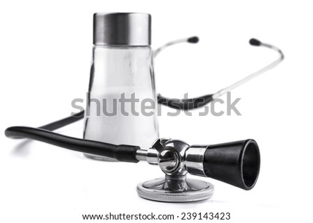 Black stethoscope  closeup with salt  isolated on white background - stock photo
