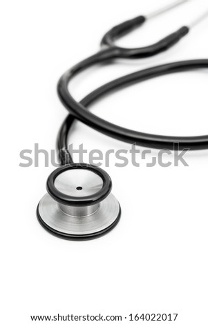 black stethoscope on a white background vertical - stock photo