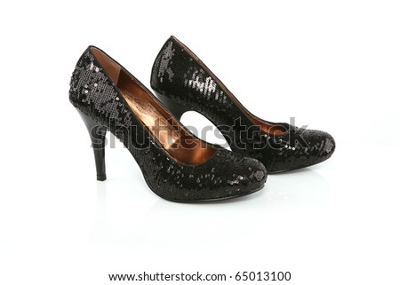 Black stiletto shoes isolated on white - stock photo
