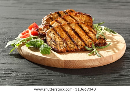 black stone and steak on wooden plate  - stock photo