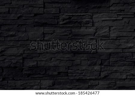 black stone wall background or texture - stock photo