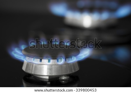 Black stove with gas flame  - stock photo