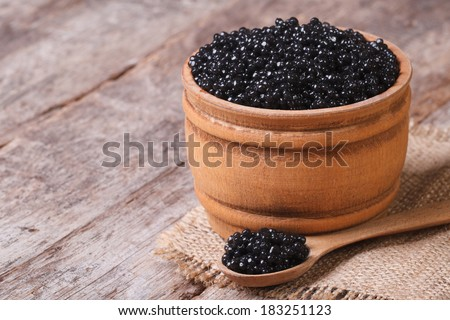 black sturgeon caviar in a wooden a barrel on the table. closeup. horizontal  - stock photo