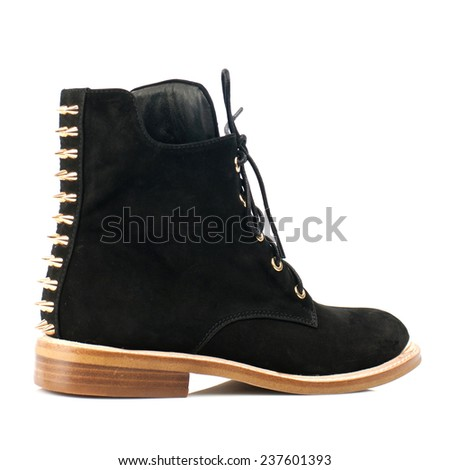 Black suede boot with shoelace isolated on white background. - stock photo
