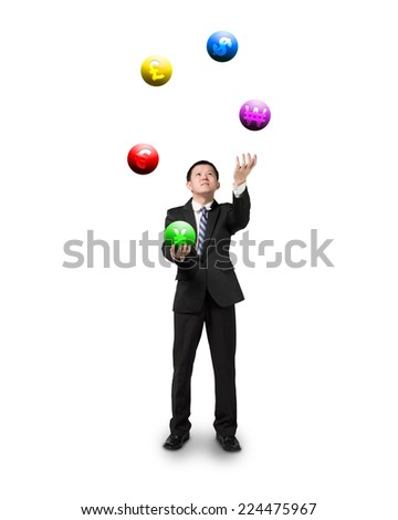 black suit businessman juggling currency symbol balls isolated on white - stock photo