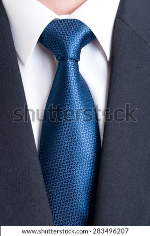 Black suit, white shirt and blue tie. Business, financial or politic concept - stock photo