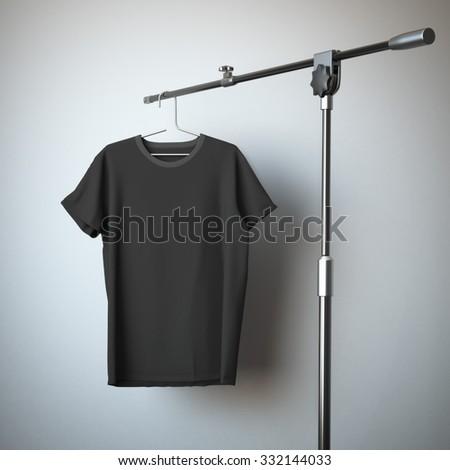 Black t-shirt hanging on the tripod  - stock photo