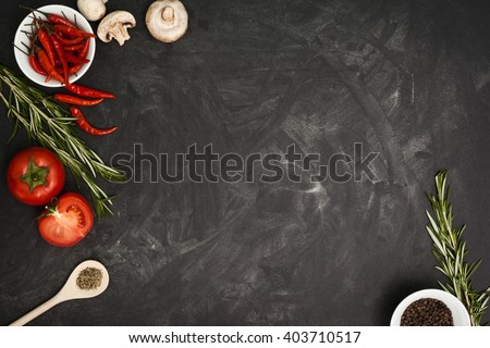 Black table with food ingredients and utensil, top view frame style - stock photo