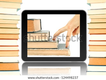 Black tablet and books around. Fingers go up on the books in tablet. Concept of growth up when you reading books - stock photo