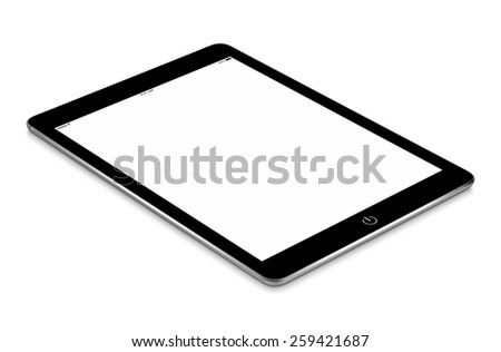 Black tablet computer with blank screen mockup lies on the surface, isolated on white background. Whole image in focus, high quality. - stock photo