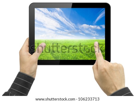Black tablet pc with nature wallpaper in hands on white background. Portable computer - stock photo