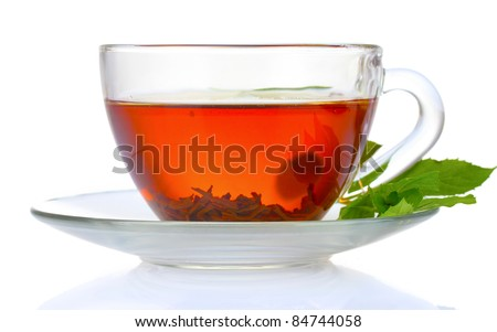 black tea  and mint in cup isolated on white - stock photo