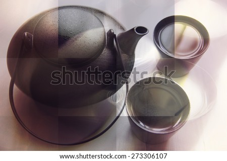 Black teapot and two teacups with tea on white table in sepia. Shallow DOF, Collage, Double Exposure effect. - stock photo