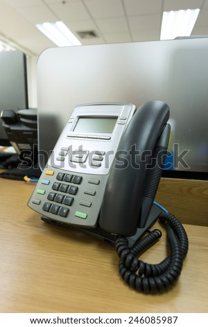 black telephone on table work of office - stock photo
