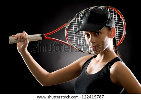 Black tennis- portrait of female player with racket - stock photo