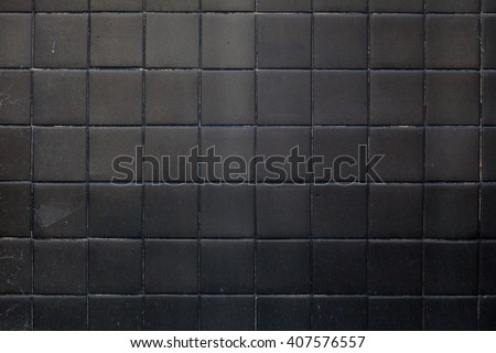 black tile background wall background pattern texture - stock photo