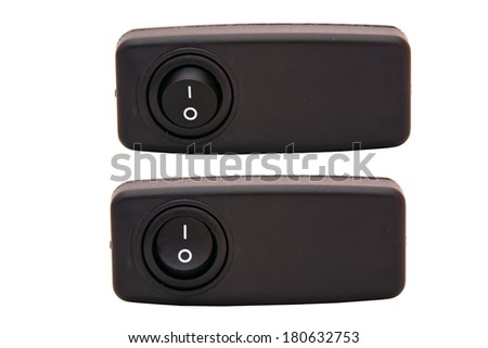 Black toggle switch on white surface - stock photo