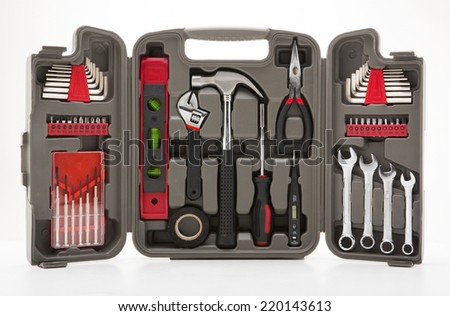 Black toolbox with different instruments isolated on white background - stock photo