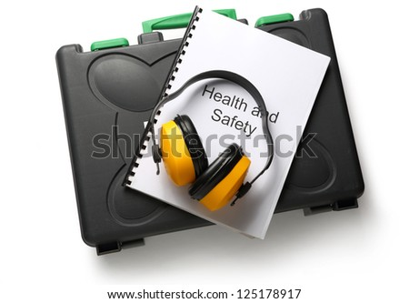 Black toolbox with earphones on white background - stock photo