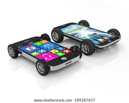 Black Touchscreen Smartphones on Wheels isolated on white background - stock photo