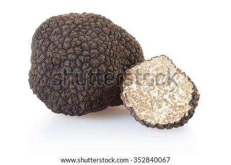 Black truffle and half isolated on white, clipping path included - stock photo