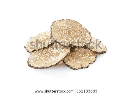 Black truffle slices heap isolated on white, clipping path included - stock photo