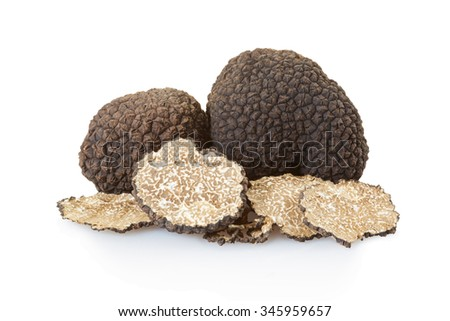 Black truffles group and slices isolated on white, clipping path included - stock photo