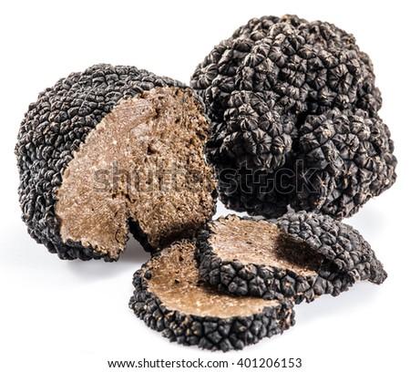 Black truffles isolated on a white background. - stock photo