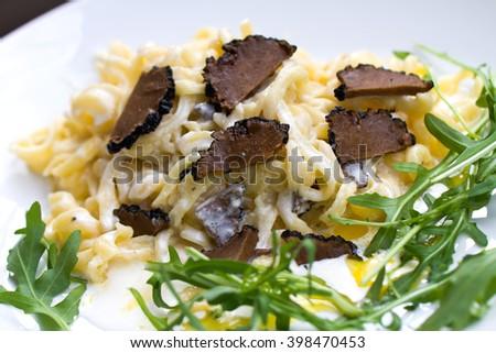 Black Truffles with Allium ursinum (ramson) and Sauce - stock photo