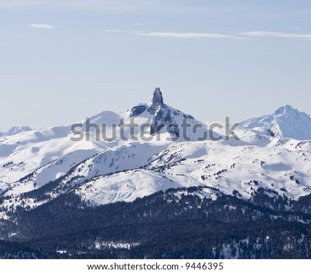Black Tusk is a pristine pinnacle of volcanic rock in Garibaldi Provincial Park of British Columbia. At 2,319 metres, the upper spire is clearly visible from the summit of Mount Whistler. - stock photo