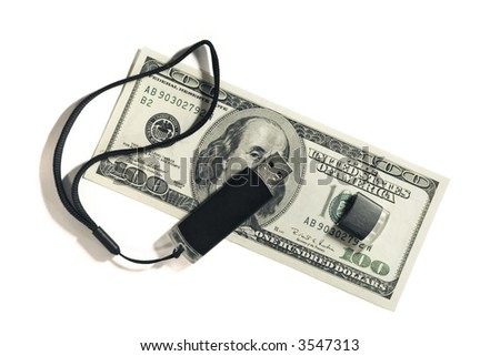 Black USB memory drive on hundred dollar bill. - stock photo