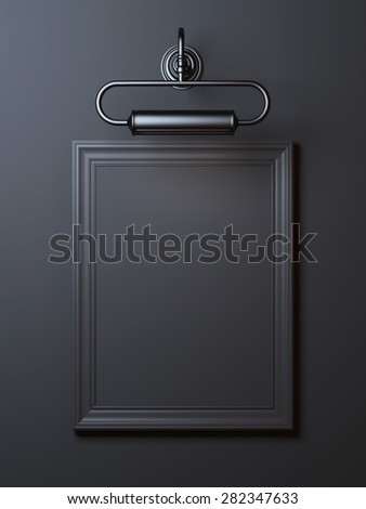 Black vintage frame with lamp - stock photo